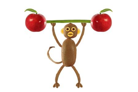 niños comiendo: Concepto de comida creativa. cómico monito del kiwi Foto de archivo