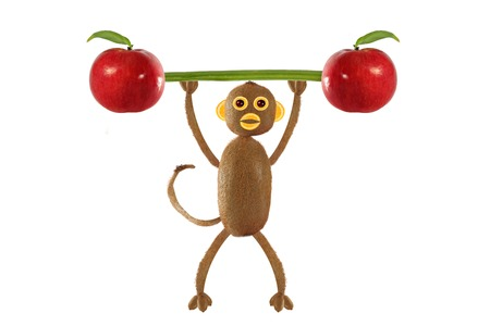 children eating: Creative food concept. Funny little monkey of the kiwi Stock Photo