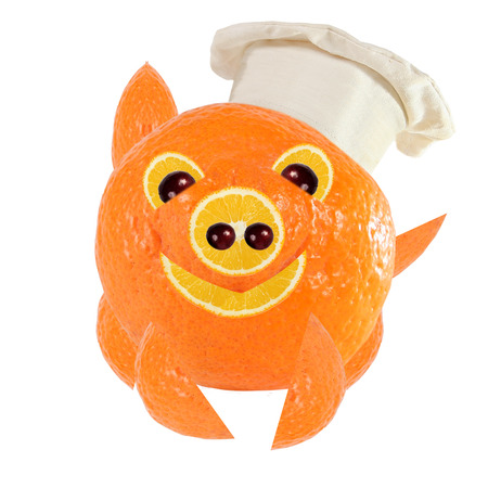 little chef: Creative food concept. Little Chef is a funny pig made from oranges.