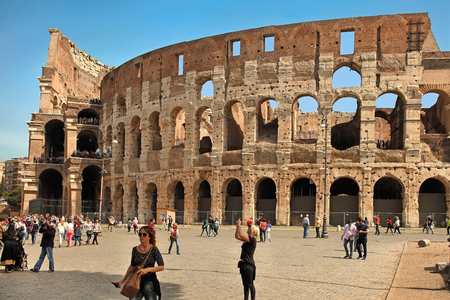 emporium: ROME, ITALY - APRIL 7, 2016: Tourists visiting the Colosseum on APRIL 7, 2016 in Rome, Italy. The Colosseum is a major tourist attraction in Rome Editorial