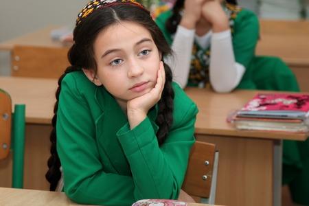 schoolroom: Ashgabad, Turkmenistan - November 4, 2014. Portrait of an unknown schoolgirl in the classroom. Editorial