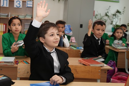 annually: Ashgabad, Turkmenistan - November 4, 2014. Group of students in lesson in the classroom . November 4, 2014.  In schools of Turkmenistan annually trains about 900 thousand children.