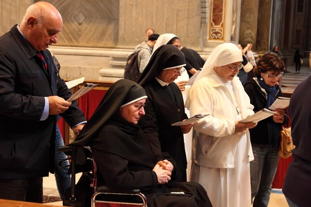 priests: Rome, Italy - APRIL 10, 2016: Thousands of nuns and priests are visiting St. Peters Basilica in the Vatican every year as pilgrims.