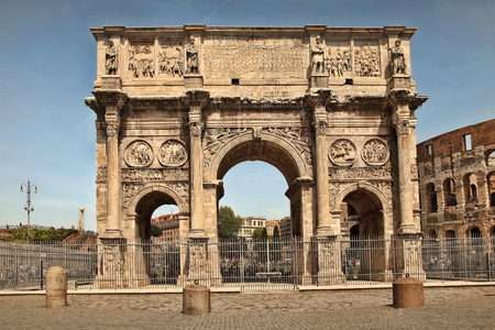 ROMA, ITALY: Arco de Constantino (Arch of Constantine) and Colosseum. The arch was erected by the Roman Senate to commemorate Constantine victory over Maxentius