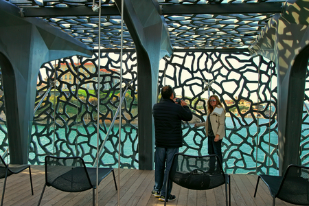 ethnology: MARSEILLE, FRANCE - October 19, 2015 : Two photographed  in the modern building of Museum of European and Mediterranean Civilizations (MuCEM). It was  inaugurated on 2013 when the city was the European Capital of Culture Stock Photo