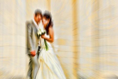 creativ: Wedding.  Radial zoom blur effect defocusing filter applied, with vintage look.