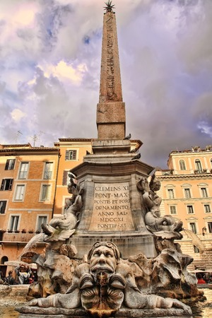commissioned: Rome, Italy - Apryl 9, 2016: Fontana del Pantheon was commissioned by Pope Gregory XIII and is located in the Piazza della Rotonda, Rome, in front of the Roman Pantheon.