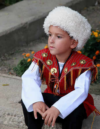 Ashgabat, Turkmenistan - September, 12, 2017.  Portrait of  unidentified serious  Asian boy.  Boy in traditional national  clothes.  Editorial