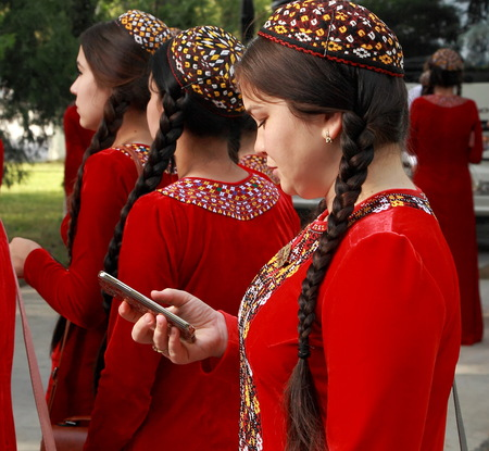 Ashgabat, Turkmenistan - May 25, 2017:  Group of students in national dress on outdoor.  Ashgabat, Turkmenistan, May 25, 2017. Editorial
