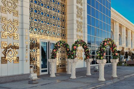 ASHGABAT, TURKMENISTAN, April 28, 2017: Entrance to the celebration hall, decorated with flowers. ASHGABAT, TURKMENISTAN, April 28, 2017.