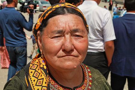 Kov-Ata, Turkmenistan - April 30, 2017: An unknown elderly woman in Turkmen national clothes. Kov-Ata, Turkmenistan - April 30, 2017