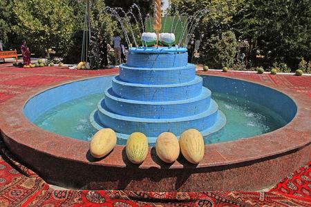 Ashgabat, Turkmenistan - August, 17 ,2017: Melon Festival in Turkmenistan. Ripe yellow melons lie on the edge of the fountain.