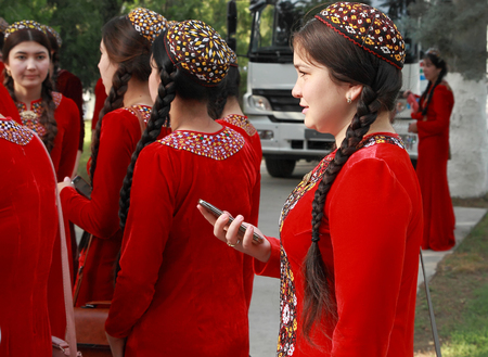 Ashgabat, Turkmenistan - May 25, 2017:  Group of students in national dress on outdoor.  Ashgabat, Turkmenistan, May 25, 2017.