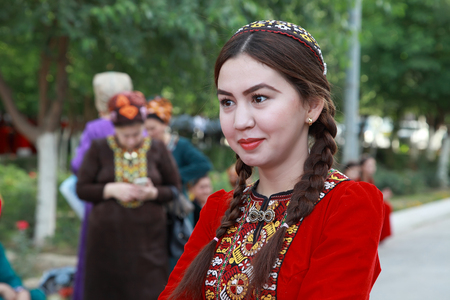 Ashgabat, Turkmenistan, May 25, 2017: Portrait of an unknown female student in a red national dress with embroidery.  Ashgabat, Turkmenistan, May 25, 2017