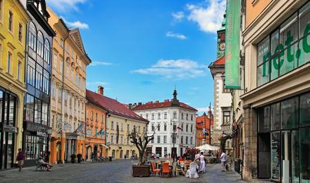 LJUBLJANA, SLOVENIA - JUNE 28, 2014: Street in the old city center of Ljubljana with street shops and cafes. LJUBLJANA, JUNE 28, 2014.