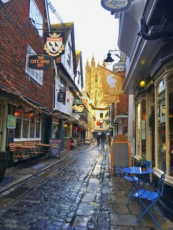 Canterbury, England, UK - December 22, 2019:  A view of the historic Canterbury Cathedral through the narrow streets. Cathedral is the Anglican mother church and seat of the Archbishop of Canterbury
