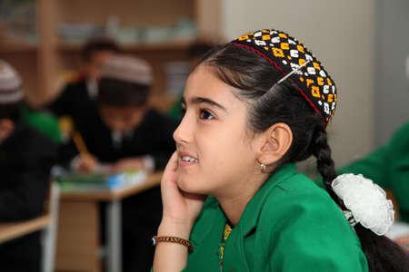 Ashgabad, Turkmenistan - November 4, 2014. Portrait of an unknown schoolgirl in the classroom. Editorial