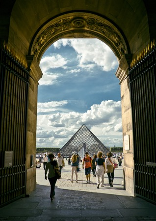 louvre pyramid: PARIS, FRANCE - 8 SEPTEMBER 2013: Louvre pyramid with silhouettes of people in foreground. Most visited art museum in the world and a historic monument. Nearly 35000 art objects. Sept 8, 2013 Paris.