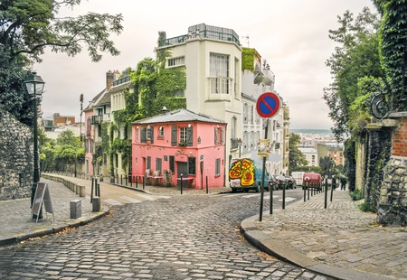 crossing street: photo of a street in Montmartre, Paris, France, in a warm light and light toning Editorial