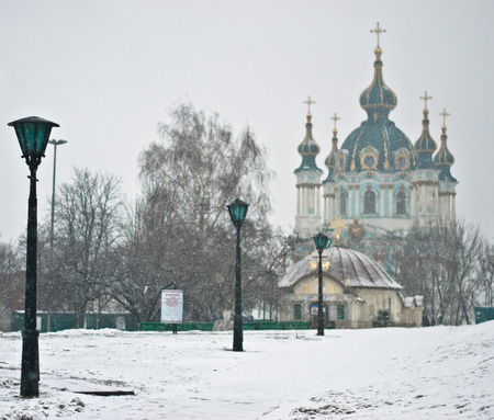 street lights: Saint Andrews Church at the top of the Andriyivskyy Descent in Kyiv with street lights, winter Stock Photo