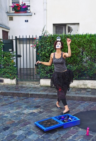 PARIS - September 08: Mime dancing with a magic ball on the head in Montmartre, Paris, France. on September 08 2013. Montmartre area is among most popular destinations in Paris,