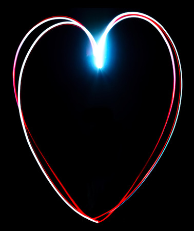 Freeze light painted heart on a black background Stock Photo