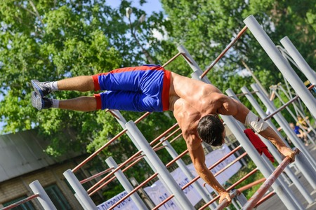 Ukraine, Krivoy Rog- JUNE 21: Unidentified sportsman performs acrobatic element during the street workout championship at Krivoy Rog City Games on June 21, 2015 in Krivoy Rog.