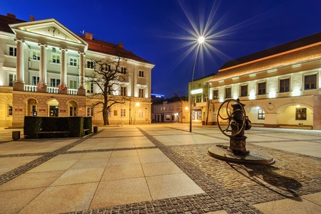 former years: City Hall in main square Rynek of Kielce, Poland Europe, in the evening.