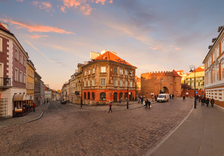 Intersection of ancient streets in the old town of Warsaw in the evening.