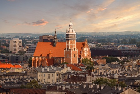 a nocturne: Roofs and the church in sunset light. Krakow, Poland.