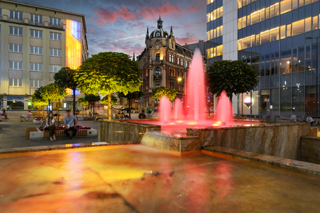 The main square in the city center of Katowice, Poland in dramatic sunset.
