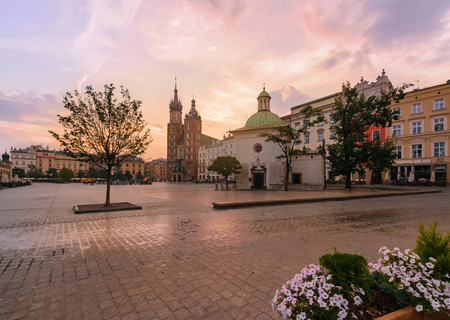 street lamp: Krakow Market Square in pink sunrise. Poland Europe. Stock Photo