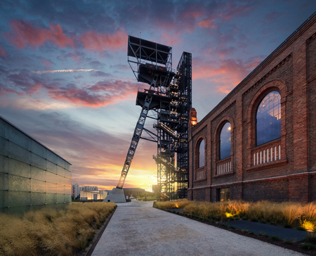 The former coal mine Katowice, seat of the Silesian Museum. The complex combines old mining buildings and infrastructure with modern architecture. Poland. Europe, during sunset.