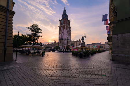 a nocturne: Morning view on the market square and town hall in Krakow. Poland.