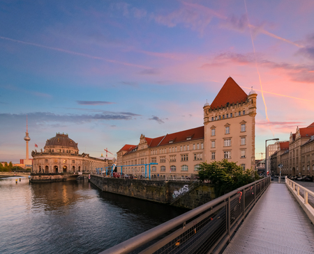 or spree: Ancient architecture of Berlin with dramatic sunset. Stock Photo