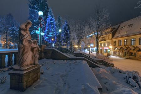 statues near the Church in main street in Zakopane, Poland. Europe.
