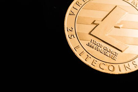 Cryptocurrency coin - Litecoin,  isolated on a black background.