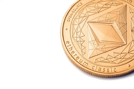 Gold cryptocurrency coin - etherum classic, isolated on a white background.