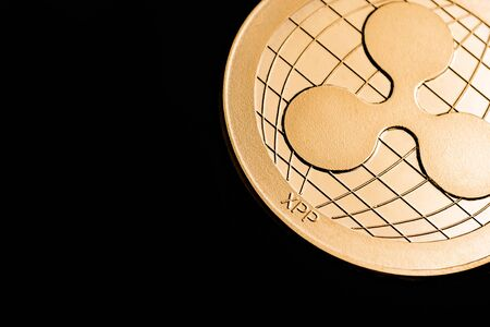 cryptocurrency coin - Ripple, isolated on a black background. Stock fotó