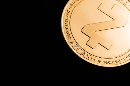 Gold cryptocurrency coin - zcash, isolated on a black background. Stock fotó