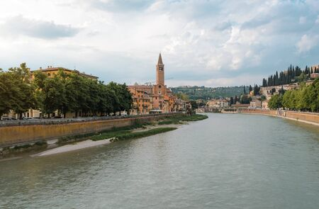 Panoramic view on the dige river in the evening in Verona. Italy 스톡 콘텐츠
