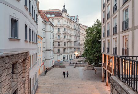 Colorful street in Vienna, Austria, in the evening. Фото со стока
