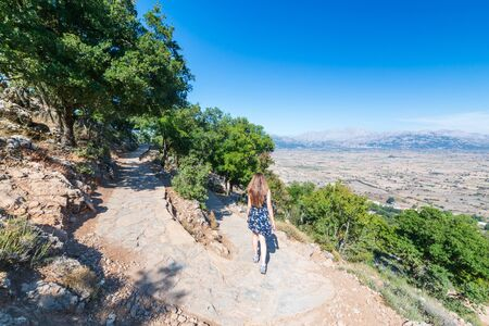 Girl tourist go from the Dikteo Andro Cave also known as birth place of Zeus in Crete, Greece