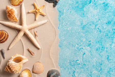 Creative layout of sand waves and sea, summer beach background with shell, sea star, vacation and travel concept, Flat lay top view copy space Minimal exotic concept. Stock Photo