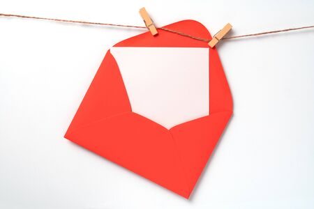 Valentines day concept. Letter on line. Clothes pegs with red wooden hearts. Symbol of love, copy space. Standard-Bild