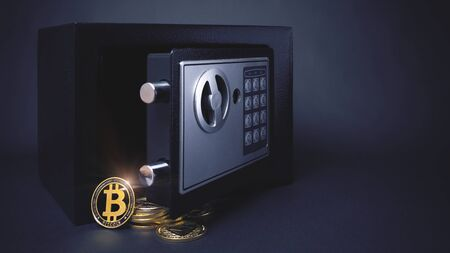 Safe Deposit. Symbol of cryptocurrency safety. Small Residential Vault with physical bitcoin. Toned soft focus picture. Copy space Stock Photo