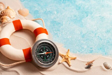 summer beach background with shell, sea star, compass life preserver, vacation and travel concept, Flat lay top view copy space, Minimal exotic concept. Creative layout of sand waves and sea.
