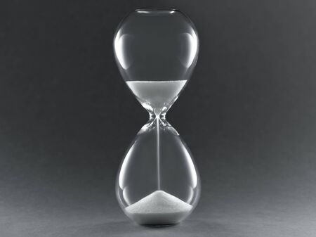 Hourglass on dark background. Symbol of passing time, concept for business deadline, urgency and running out of time.. Stockfoto