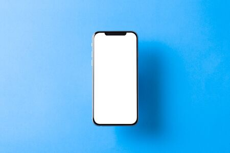 Smartphone mockup. New black frameless hovering smartphone with white screen. Isolated on color background. Based on high-quality studio shot. Smartphone frameless design concept. Imagens