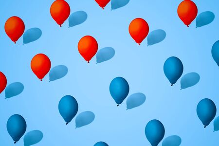 balloons red and blue color. Symbol of division of society. Concept of confrontation between races, religion and States.